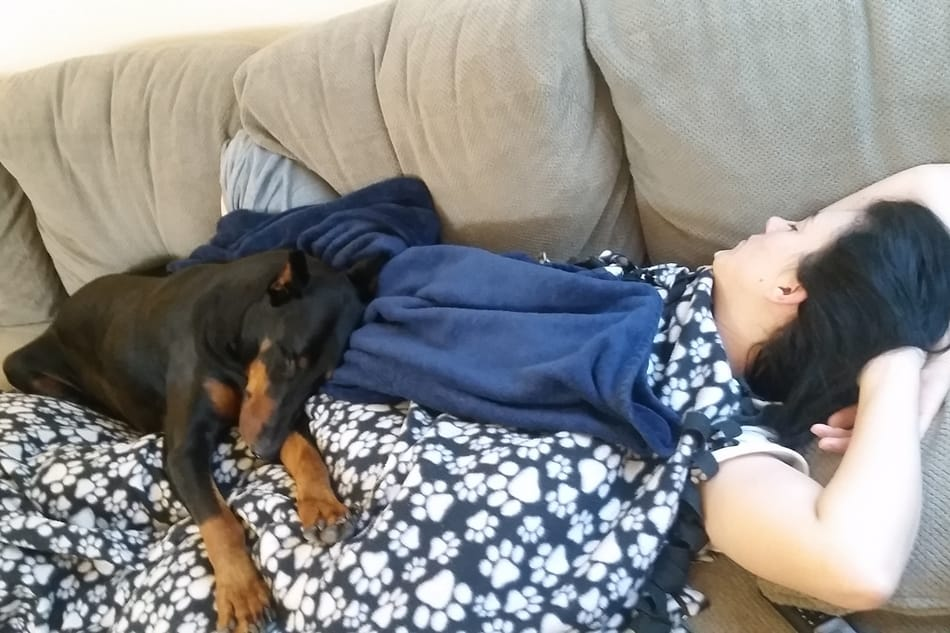 My Doberman sleeping on my wife.