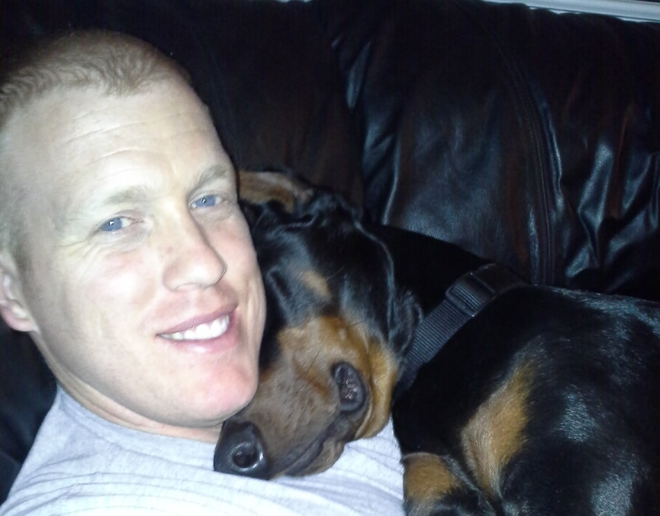 My Doberman asleep on me.